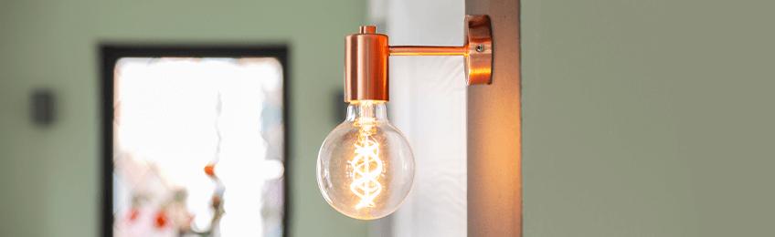 Lámpara de pared de latón
